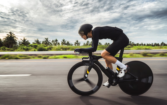 """Asian men are cycling """"time trial bike"""" in the morning"""
