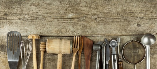Kitchen tools on a wooden table. Cook's tools. Traditional equipment of rural cuisine.