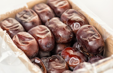 dates, phoenix dactylifera in packing container, close up