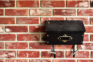 Family Mailbox on Brick Wall