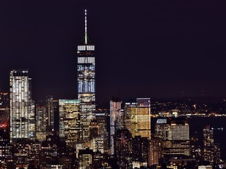 The Freedom Tower, Financial District, and the skyline of downtown Manhattan at night.