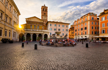 Basilica di Santa Maria in Trastevere and Piazza di Santa Maria in Trastevere at sunset, Rome, Italy. Trastevere is rione of Rome, on west bank of Tiber in Rome. Architecture and landmark of Rome.