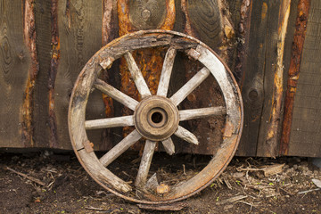 Old wooden wheel for a horse carriage