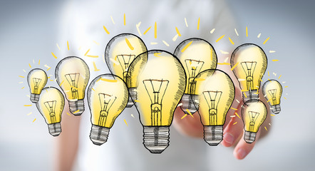 Businessman touching hand-drawn lightbulb with his finger