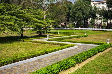 landscape design. walkway in the Park, lawn, making shrubs