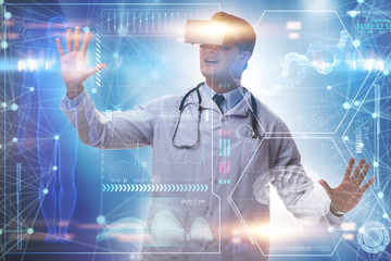 Doctor examining x-ray images using virtual reality glasses