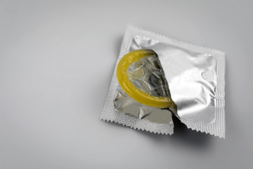 Condom close-up. Contraceptive protection from pregnancy, AIDS.