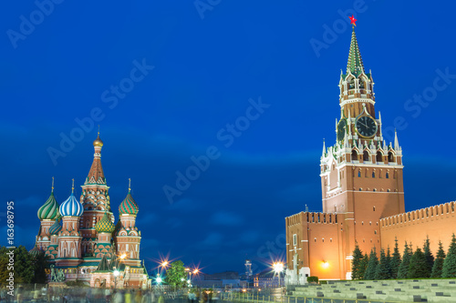 Blue hour sunset view of St  Basil Cathedral and Kremlin tower at