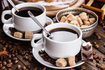 Two cups of espresso on brown napkin