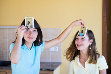 Girls playing game with photos