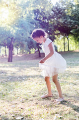 little girl dancing outdoors