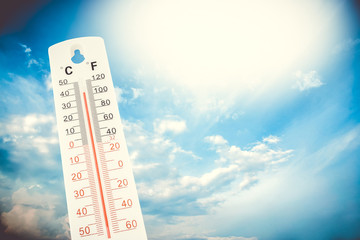 Tropical temperature, measured on an outdoor thermometer, global heat wave, environment concept.