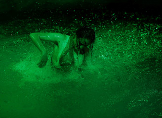 """An actress takes part in the dress rehearsal of an adaption of Roman poet Ovid's """"Metamorphoses"""" during the Malta International Arts Festival in Valletta"""