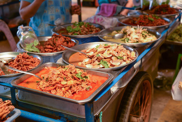 Thai street food on barrow in fresh market.