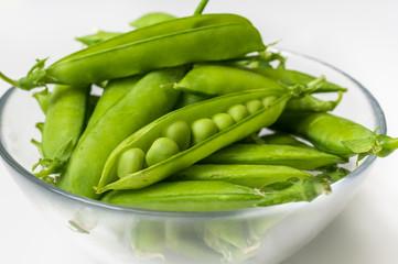 Fresh green peas in bowl