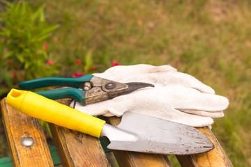 worked dirty garden tools composition laying on a bench