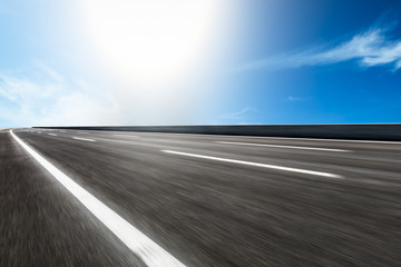 Motion blurred asphalt road background