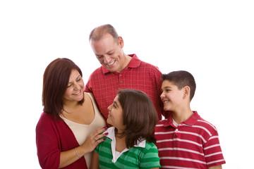 Hispanic family smiling isolated on white.