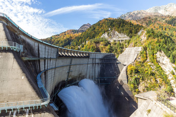 Deurstickers Dam Discharge water from kurobe dam