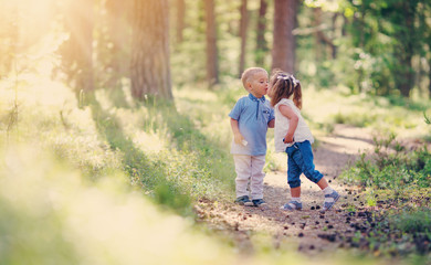 Boy and boy kissing in the forest
