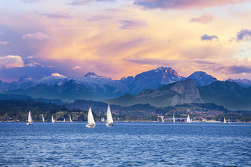 Yacht regatta on the alpine mountain lake