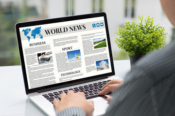 Man hands holding computer with app world news screen cafe