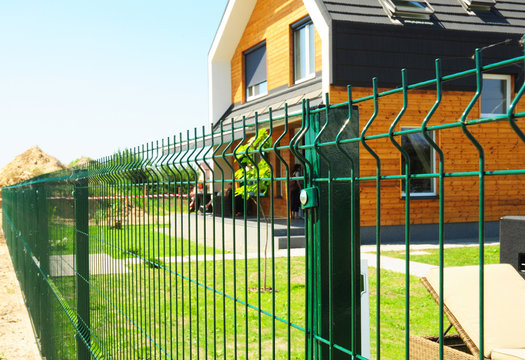 Metal fencing with modern house outdoor. Metal fence design.