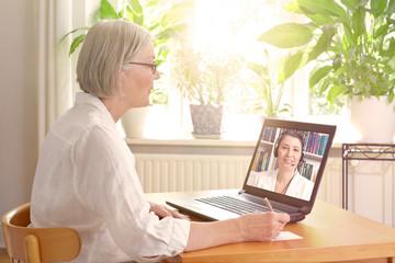 senior woman laptop online therapy