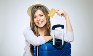 Smiling woman holding credit card.