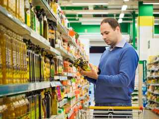 Man making choise about product in supermarket