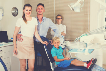 Family of three is on dentist's receptionist