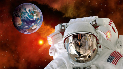 Astronaut planet Earth spaceman helmet stars space suit galaxy universe. Elements of this image furnished by NASA.
