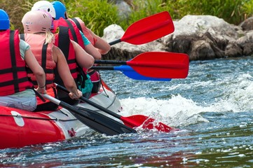 Rafting. Close-up view of oars with splashing water.