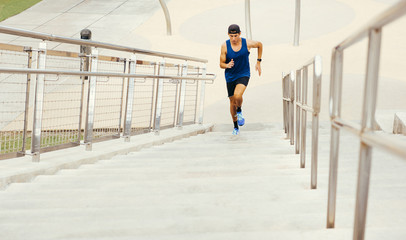 Young man exercising outdoors, running up steps, high angle view, South Point Park, Miami Beach, Florida, USA
