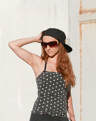 model with hat and sunglasses