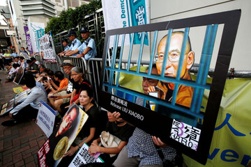 Pro-democracy activists stage a sit-in protest demanding the release of Nobel laureate Liu Xiaobo in Hong Kong