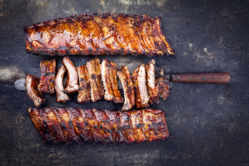 Acrylic Prints Grill / Barbecue Barbecue Pork Spare Ribs as top view on an old rusty metal sheet