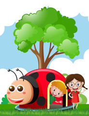 Two kids playing in ladybug house