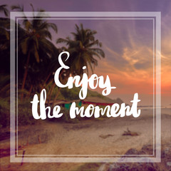 Motivational Quote on purple color background Enjoy the moment
