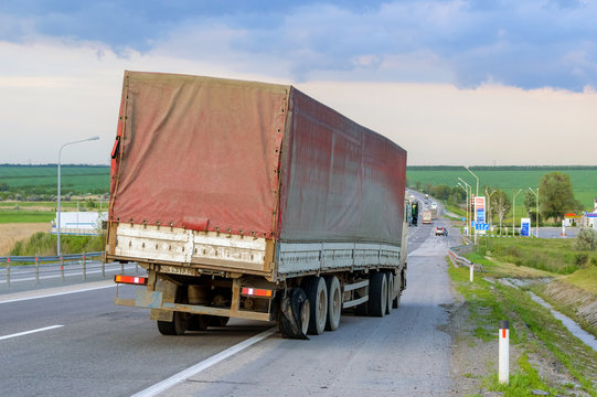Flat out and damaged wheeler semi truck burst tires by highway street