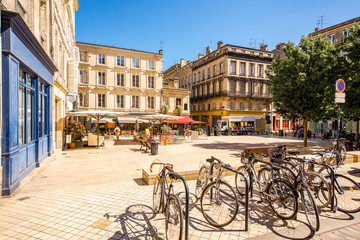 View on the small square with bicycles in Bordeaux city in France