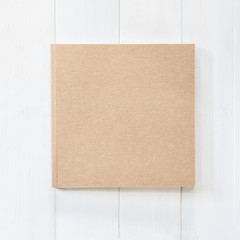 Blank book mock up square-size catalog magazines, brochure or note cover template recycle brown paper texture flat lay on white color wood table from top view