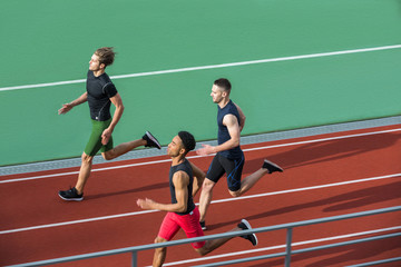 Handsome multiethnic athlete group run