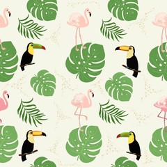 Seamless decorative pattern with flamingo, toucan and tropical leaves