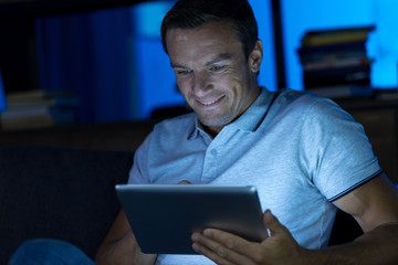 Enthusiastic passionate man reading something online