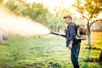 Industrial worker doing pest control using insecticide