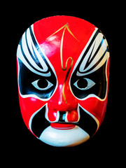 Traditional chinese opera mask isolated on black background.