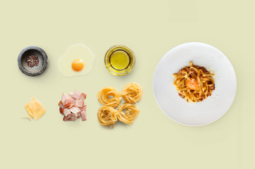 Cooking ingredients for italian food, carbonara, isolated on yellow background
