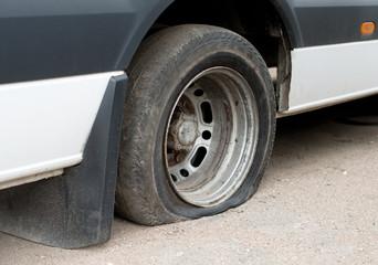Rear flat tire of minibus.