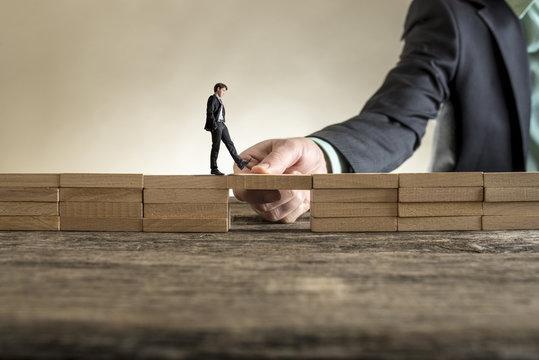 Building bridge to span a gap for little businessman
